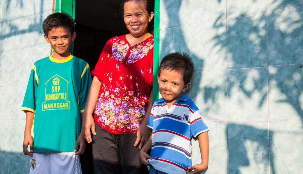 Woman and sons at home in Indonesia