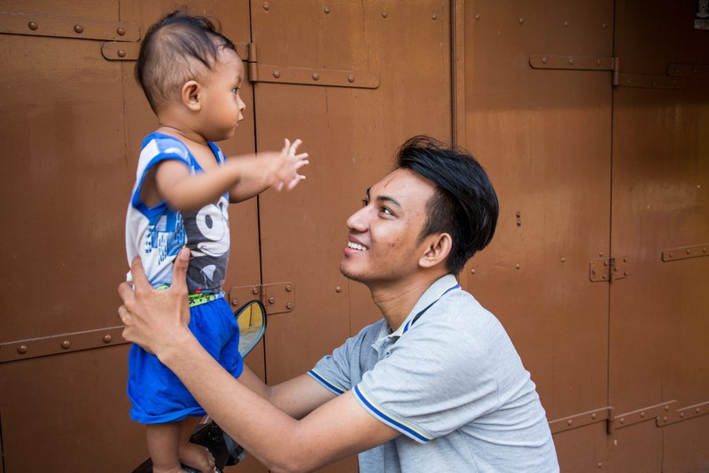 Man with child in Indonesia